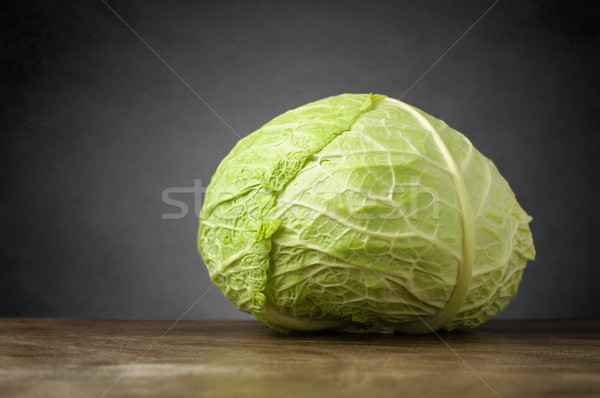 Cabbage on wooden table Stock photo © CsDeli