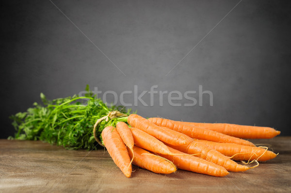 Fresh carrots on wooden table Stock photo © CsDeli