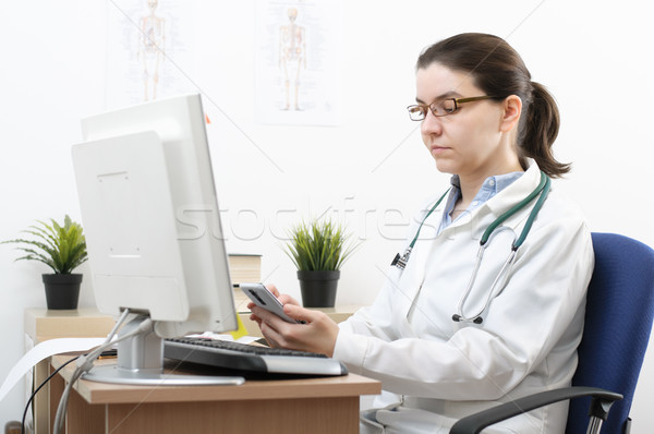 Portrait of a doctor using smartphone Stock photo © CsDeli