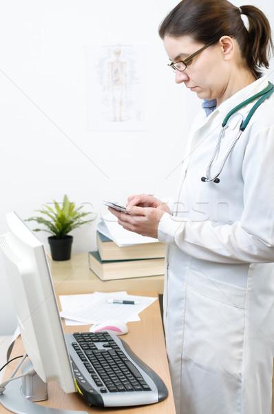 Portré orvos okostelefon női iroda telefon Stock fotó © CsDeli