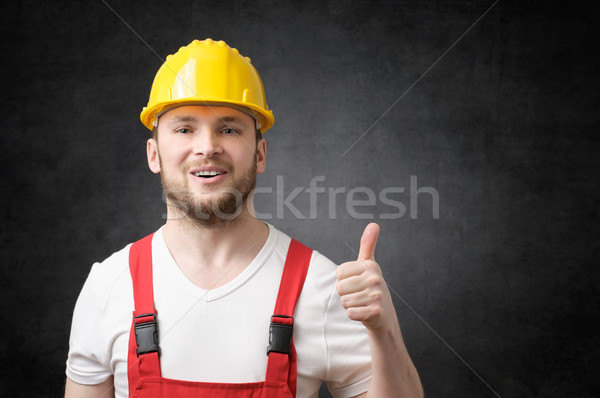Happy worker showing thumbs up sign Stock photo © CsDeli