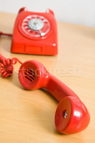 Vintage красный телефон деревянный стол бизнеса телефон Сток-фото © ctacik