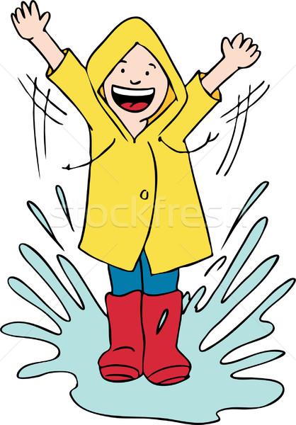 Stock photo: Boy Splashing in Puddle