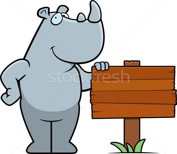 Rinocer semna fericit desen animat în picioare lemn Imagine de stoc © cthoman