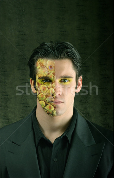 young man with half face painted Stock photo © curaphotography