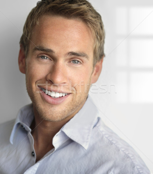 Smiling happy guy Stock photo © curaphotography