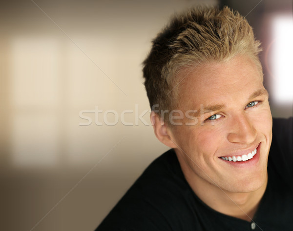 Smiling young man Stock photo © curaphotography