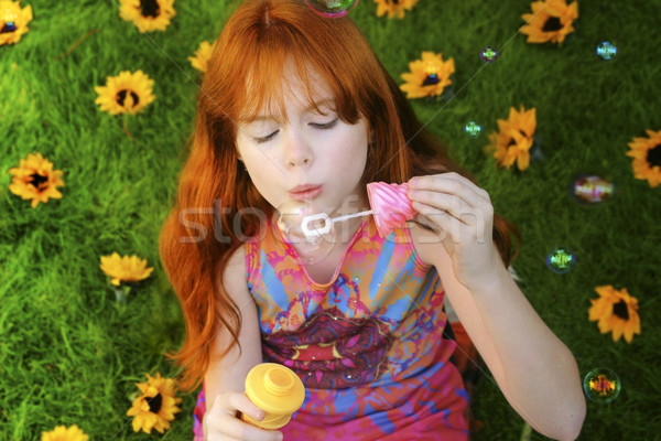 Red headed girl blowing bubbles Stock photo © curaphotography