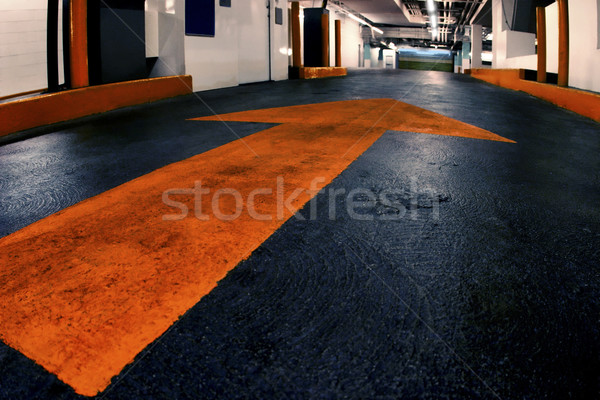 photo of garage with painted arrow Stock photo © curaphotography