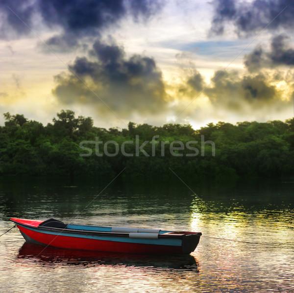 Roeiboot Rood mooie meer dramatisch hemel Stockfoto © curaphotography