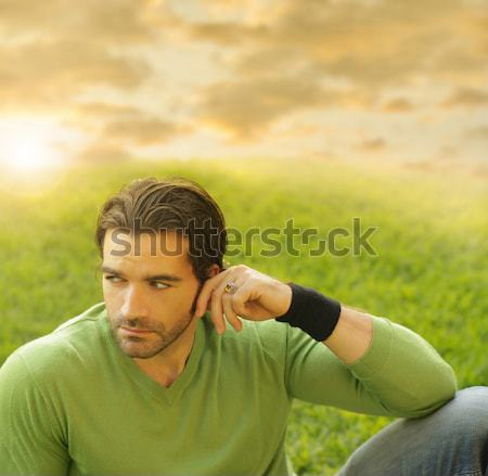Portrait of a relaxed good-lookiing young man in natural setting Stock photo © curaphotography