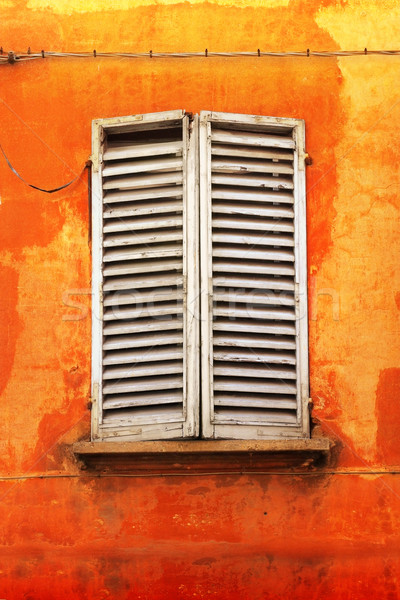 Shutters on orange wall Stock photo © curaphotography