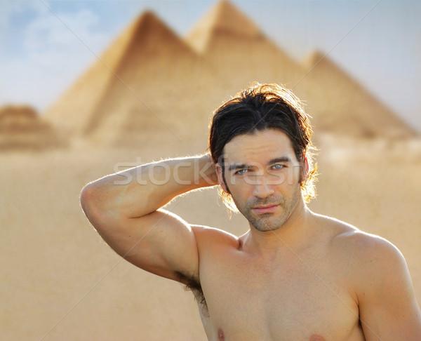 Young man at pyramids Stock photo © curaphotography