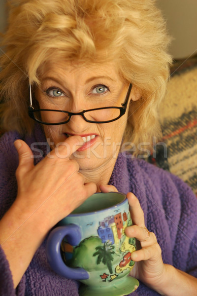 Woman biting figner Stock photo © curaphotography