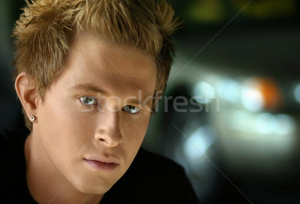 young man in garage Stock photo © curaphotography