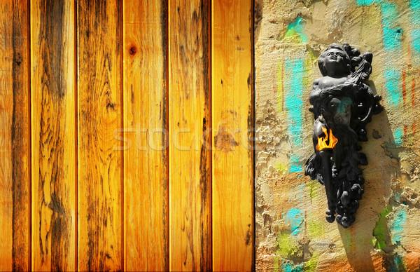 Cherub anioł ściany brąz posąg płomień Zdjęcia stock © curaphotography
