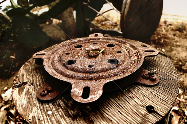 photo of wooden wheel with rusty metal Stock photo © curaphotography