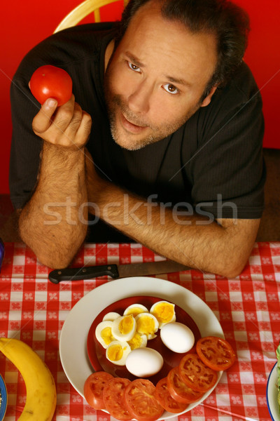 man with tomato Stock photo © curaphotography