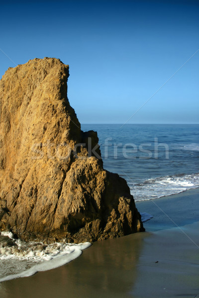 Large Rock formation on Beach Stock photo © curaphotography