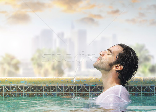 Estate divertimento giovani di bell'aspetto uomo piscina Foto d'archivio © curaphotography