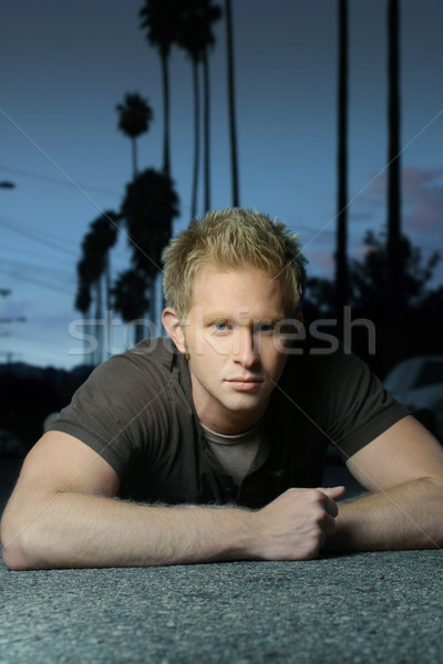 blond guy laying on ground Stock photo © curaphotography