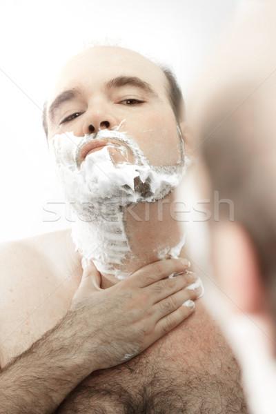 Man shaving face Stock photo © curaphotography