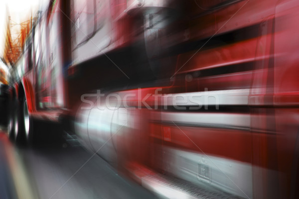 Stock photo: photo of moving red truck