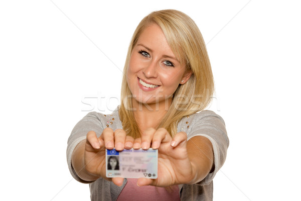 Young woman showing her driver's license Stock photo © Cursedsenses