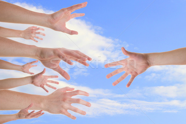 Hands reaching for a helping hand Stock photo © Cursedsenses
