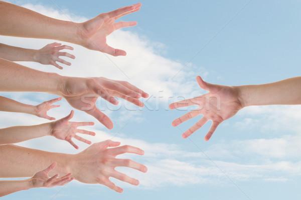 Kezek segítő kéz néhány kaukázusi kéz test Stock fotó © Cursedsenses