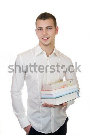 Young businessman carrying books Stock photo © Cursedsenses