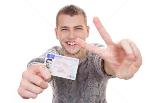 Young man showing his driver license Stock photo © Cursedsenses