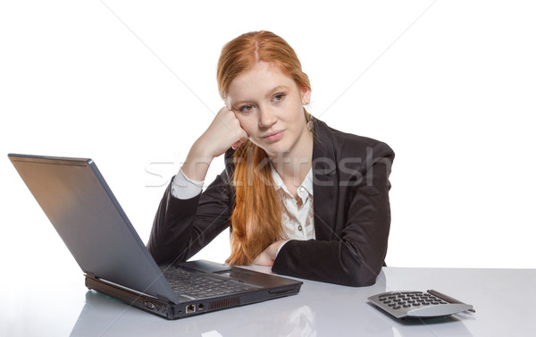 Young businesswoman sitting in front of her notebook Stock photo © Cursedsenses