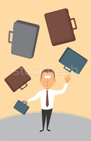 Businessman juggling with briefcases Stock photo © curvabezier