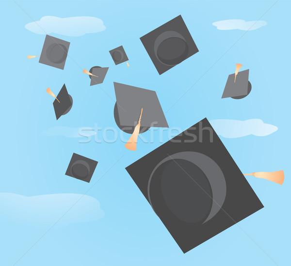Graduation caps tossed up Stock photo © curvabezier