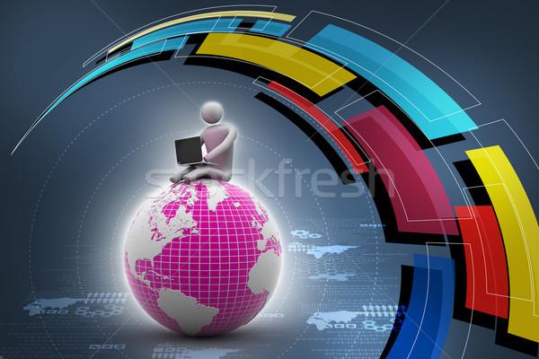 Adam oturma dünya dizüstü bilgisayar üst dünya Stok fotoğraf © cuteimage