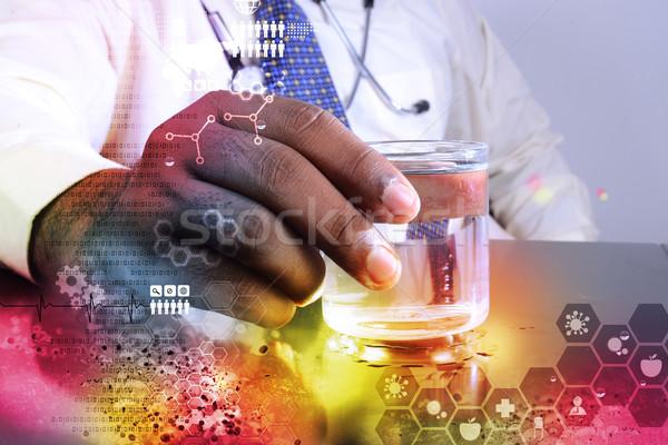 человека стетоскоп стекла воды медицинской Сток-фото © cuteimage