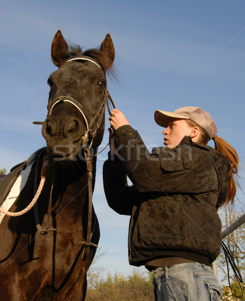 teenager, bridle and horse Stock photo © cynoclub