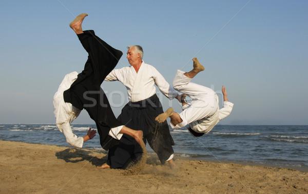 Aikido plaj üç yetişkin eğitim adam Stok fotoğraf © cynoclub