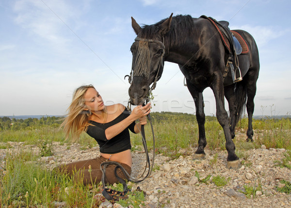 teenager and black stallion in nature Stock photo © cynoclub