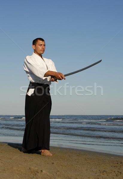 Jonge man opleiding aikido strand man zee Stockfoto © cynoclub