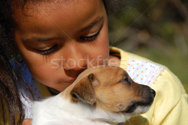 Stock photo: little girl and puppy