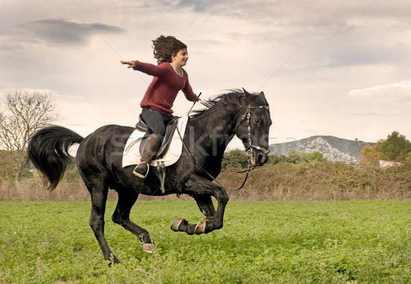 riding girl and black stallion Stock photo © cynoclub