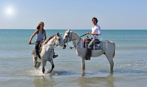 Paardrijden zee vader dochter arabisch paarden Stockfoto © cynoclub