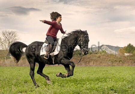 Fiatal lovaglás lány fekete csődör természet Stock fotó © cynoclub