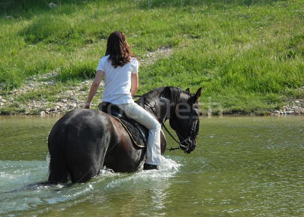 Jazda konna kobieta rzeki młoda kobieta czarny ogier Zdjęcia stock © cynoclub
