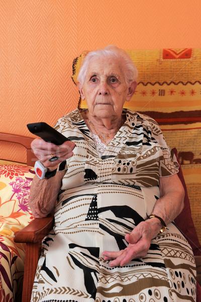 Senior donna telecomando tv canale televisione Foto d'archivio © cynoclub