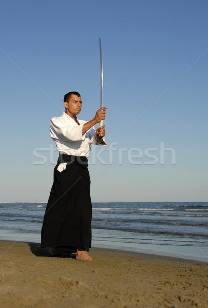 Aikido jonge man opleiding strand man zee Stockfoto © cynoclub