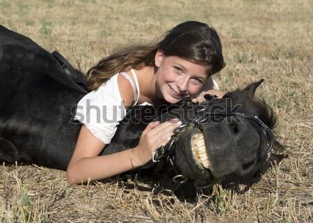 Stockfoto: Glimlachend · paardrijden · meisje · jong · meisje · zwarte · hengst