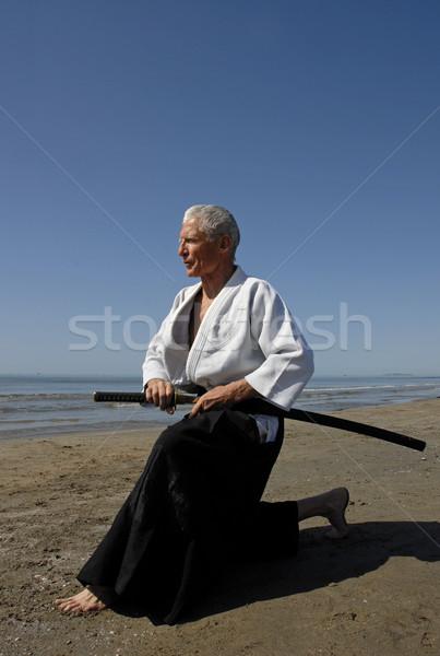 Eğitim aikido bir yaşlı adam plaj deniz Stok fotoğraf © cynoclub